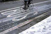 bike rider using bus lane on snowy street