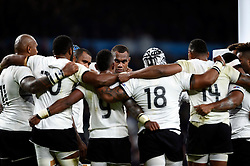The Fiji team huddle together after the match - Mandatory byline: Patrick Khachfe/JMP - 07966 386802 - 18/09/2015 - RUGBY UNION - Twickenham Stadium - London, England - England v Fiji - Rugby World Cup 2015 Pool A.