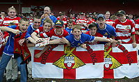 Photo. Andrew Unwin<br /> Doncaster Rovers v York, Nationwide League Division Three, Earth Stadium, Belle Vue, Doncaster 24/04/2004.<br /> Doncaster fans cheer on their team.