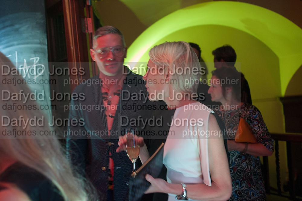 Giles Deacon; Emily King, DINNER TO CELEBRATE THE ARTISTS OF FRIEZE PROJECTS AND THE EMDASH AWARD 2012 hosted by ANDREA DIBELIUS founder EMDASH FOUNDATION, AMANDA SHARP and MATTHEW SLOTOVER founders FRIEZE. THE FORMER CENTRAL ST MARTIN'S SCHOOL OF ART AND DESIGN, SOUTHAMPTON ROW, LONDON WC1. 11 October 2012
