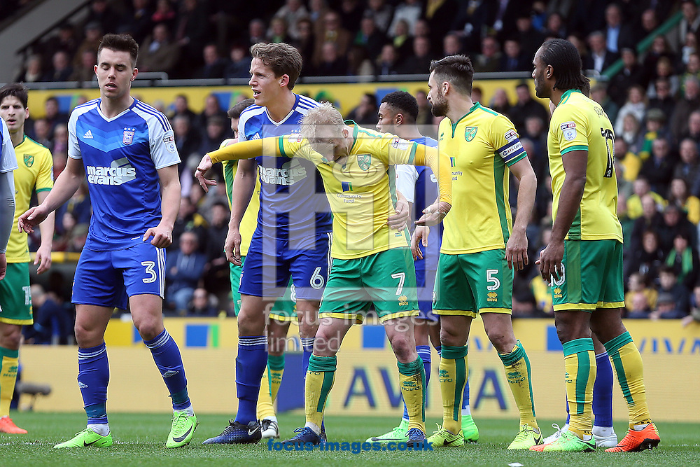 Steven Naismith of Norwich holds off Christophe Berra of Ipswich Town during the Sky Bet Championship match at Carrow Road, Norwich<br /> Picture by Paul Chesterton/Focus Images Ltd +44 7904 640267<br /> 26/02/2017