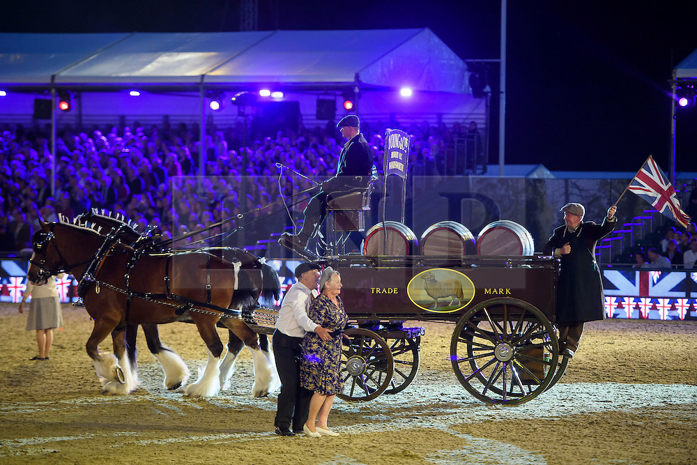 © Licensed to London News Pictures. 15/05/2016. Windsor, UK.  A period costumed horse and carriage. An evening event held at the Royal Windsor Horse show to celebrate the 90th birthday of HRH Queen Elizabeth II. Acts from arounds the world have been invited to perform at the evening event, set in the grounds of Windsor Castle. Photo credit: Ben Cawthra/LNP