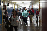Students walk between classes at Integrated Arts & Technology High School in Rochester, New York on Tuesday, February 23, 2016. The district is in the early stages of a planned 1:1 device to student program.