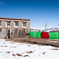 Traditional Tibetan house with drying clothes, Tagong, Sichuan, China