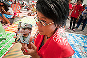 """17 MAY 2010 - BANGKOK, THAILAND: A woman with a photo of Seh Daeng, the Red Shirts' unofficial military commander, cried upon hearing of Seh Daeng's death Monday. The Thai government announced Monday that renegade army general and the Red Shirts unofficial military commander and staunch supporter, Thai Army Maj. Gen. KHATTIYA """"Seh Daeng"""" SAWASDIPOL, died Monday from wounds he suffered when a sniper shot him in the head on May 12 while he was being interviewed by an American reporter. When the announcement was read to the Red Shirt protesters still camped out in Ratchaprasong intersection in Bangkok many started weeping.   PHOTO BY JACK KURTZ"""