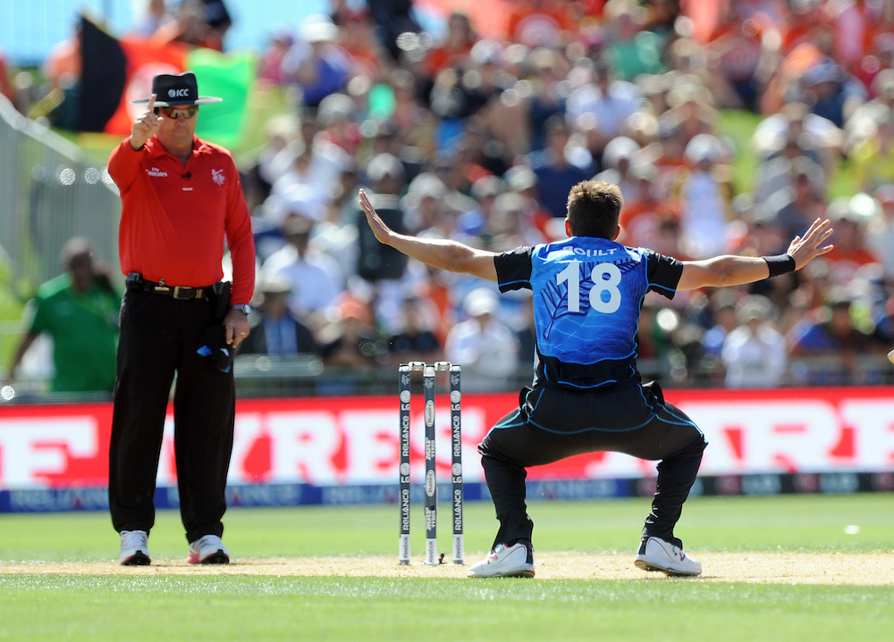 New Zealand's Trent Boult clams the wicket of Afghanistan's Javed Ahmadi for 1 in the ICC Cricket World Cup at McLean Park, Napier, New Zealand, Sunday, March 08, 2015. Credit:SNPA / Ross Setford