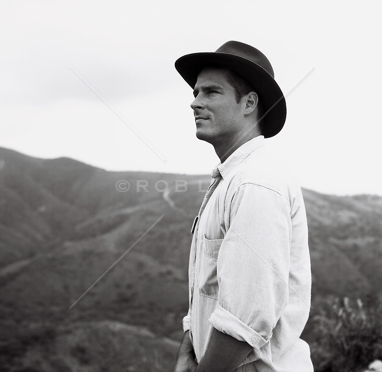 man in a hat looking at the mountain range in Californa