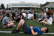 AUGUST 24, 2018  ATHENS, OHIO:<br /> Derek Demlow, of Medina, Ohio, lies on the football field in with around 4000 other incoming freshman on the football field in Peden Stadium before posing for the first year class photo on August 24, 2018 in Athens, Ohio.