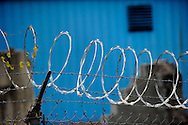 Razor wire around an industrial site