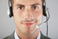 Businessman Wearing Telephone Headset
