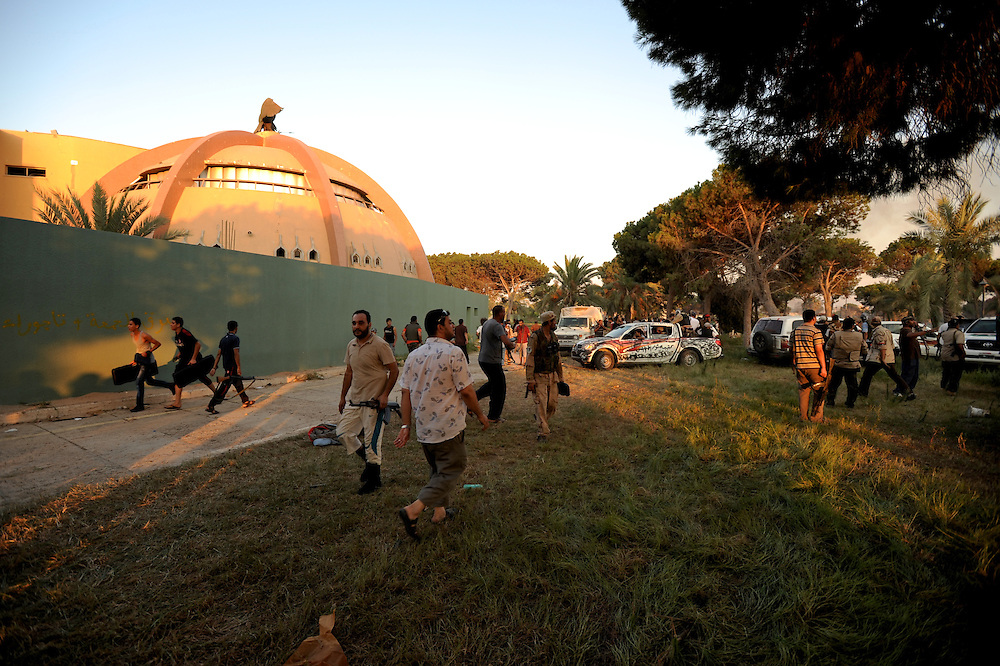 Rebel fighters and local residents gather at the gardens of Muammar Gaddafi's Bab Al Azizia compound in Tripoli