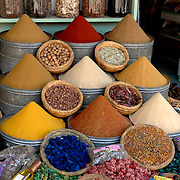 Scenes like this spice shop are everywhere inside the medina (old city) of Marrakech, Morocco.  The variety, freshness and availbility of spices in Moroccois amazing.  These displays in the spice shops are so colorful and are always so well done.