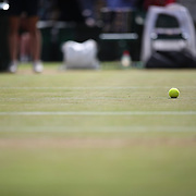 LONDON, ENGLAND - JULY 14: A tennis ball on Center Court during the Gentlemen's Singles Semi-finals of the Wimbledon Lawn Tennis Championships at the All England Lawn Tennis and Croquet Club at Wimbledon on July 14, 2017 in London, England. (Photo by Tim Clayton/Corbis via Getty Images)