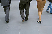 3 business people walking
