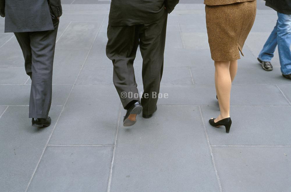 3 business people walking