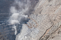 "Chuquicamata, or ""Chuqui"" as it is more familiarly known, is by excavated volume the biggest open pit copper mine in the world, located in the north of Chile, just outside of Calama, 215 km northeast of Antofagasta and 1,240 km north of the capital, Santiago. The mine is owned and operated by Codelco, a Chilean state enterprise, since the Chilean nationalization of copper in the late 1960s and early 1970s. Its depth of 850 metres (2,790 ft) makes it the second deepest open-pit mine in the world (after Bingham Canyon Mine in Utah, USA)."