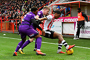 Tristan Abrahams (19) of Exeter City holds off two Grimsby Town players during the EFL Sky Bet League 2 match between Exeter City and Grimsby Town FC at St James' Park, Exeter, England on 29 December 2018.