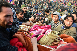 November 20, 2018 - Pulwama, Jammu and Kashmir, India - Kashmiri Muslim people carry the dead body of the Rebel Basharat Ahmad who was Killed during an encounter in Shopian district of Indian Administered Kashmir on 20 November 2018. Four rebels were killed in a gunfight between Indian Forces and Kashmiri Rebels who were identified as Inam ul Haq of Feripora, Abid Nazir Chopan of Paddarpora, Mehraj ud Din Najar of Drawni Zainapora and Basharat Ahmad of Chotigam. Two Indian Paratroopers were also killed in the gunfight. (Credit Image: © Muzamil Mattoo/Pacific Press via ZUMA Wire)