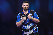 Luke Humphries wins his first round match against Devon Petersen during the PDC William Hill Darts World Championship at Alexandra Palace, London, United Kingdom on 13 December 2019.