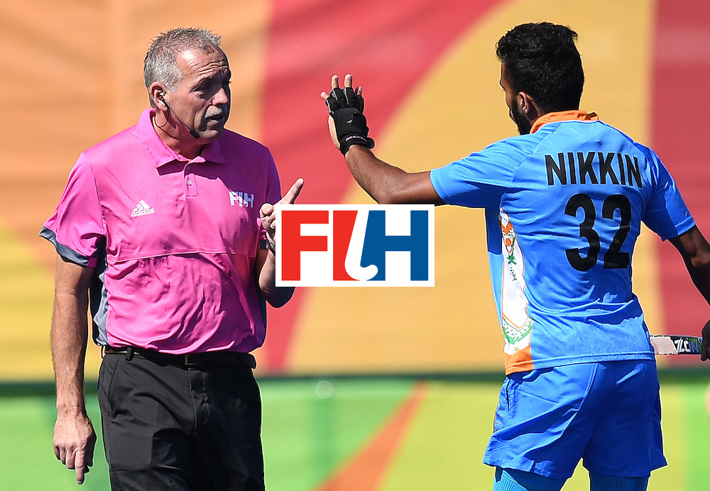 India's Chandanda Thimmaiah (R) gestures at the referee during the men's field hockey Netherland's vs India match of the Rio 2016 Olympics Games at the Olympic Hockey Centre in Rio de Janeiro on August, 11 2016. / AFP / MANAN VATSYAYANA        (Photo credit should read MANAN VATSYAYANA/AFP/Getty Images)