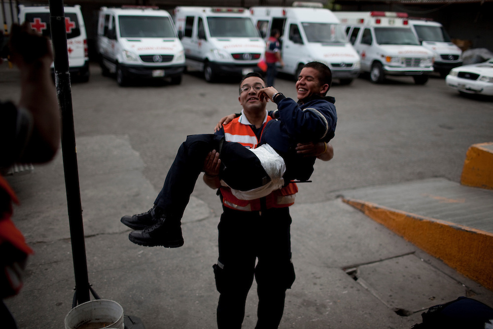 Members of the Rescate (Juarez's Rescue team) joke with each other in Ciudad Juarez, Chihuahua Mexico on May 2, 2010. ..