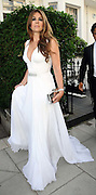 25.JUNE.2009 - LONDON<br /> <br /> A VERY ELEGANT LOOKING LIZ HURLEY LEAVING HER HOUSE WITH HUSBAND ARUN TO GO TO ELTON JOHN'S WHITE TIARA BALL IN WINDSOR LIZ IS SHOWING OFF HER CLEVAGE.<br /> <br /> BYLINE: EDBIMAGEARCHIVE.COM<br /> <br /> *THIS IMAGE IS STRICTLY FOR UK NEWSPAPERS AND MAGAZINES ONLY* <br /> *FOR WORLD WIDE SALES AND WEB USE PLEASE CONTACT EDBIMAGEARCHIVE - 0208 954 5968*