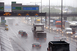 © Licensed to London News Pictures. 27/05/2014<br /> Traffic on the left of this picture heading clockwise into Kent from the Dartford Bridge.<br /> More May Rain today (27.05.2014)<br /> Heavy rain this afternoon is causing chaos on the M25 anti-clockwise towards  QE2 Bridge the Dartford Crossing with speed  restrictions of 40mph in place due to the bad weather traffic is at a virtual standstill.<br /> Photo credit :Grant Falvey/LNP