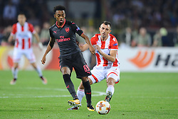 Joseph Willock of Arsenal vs Nenad Krsticic of Crvena Zvezda during football match between NK Crvena Zvezda Beograd and Arsenal FC in Group H of UEFA Europa League 2017/18, on October 19, 2017 in Stadion Rajko Mitic, Belgrade, Serbia. Photo by Nebojsa Parausic / Sportida