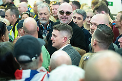 © Licensed to London News Pictures . 27/09/2018 . London , UK . Hundreds of Tommy Robinson supporters surround Robinson in Ludgate Hill station , after a new trial date is set and Robinson leaves the court . Supporters of former EDL leader Tommy Robinson (real name Stephen Yaxley-Lennon ) gather outside the Old Bailey , as Robinson faces a retrial for Contempt of Court following his actions outside Leeds Crown Court in May 2018 . Robinson was already serving a suspended sentence for the same offence when convicted in May and served time in jail as a consequence , but the newer conviction was quashed by the Court of Appeal and a retrial ordered . Photo credit: Joel Goodman/LNP