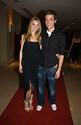 MARK EMMS and JESSICA WELLS at a party to launch Three's A Crowd held at the Mayfair Hotel, Berkley Street, London on 5th December 2006.<br /><br />NON EXCLUSIVE - WORLD RIGHTS
