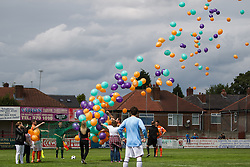 © Licensed to London News Pictures . 02/08/2015 . Droylsden Football Club , Manchester , UK . Balloon launch before the match . Celebrity football match in aid of Once Upon a Smile and Debra , featuring teams of soap stars . Photo credit : Joel Goodman/LNP