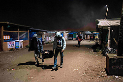 October 24, 2016 - Calais, France - Migrants walking the jungle early in the morning to go to the warehouse to take the bus. Calais 24/10/2016  (Credit Image: © Guillaume Pinon/NurPhoto via ZUMA Press)