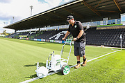 Groundsman Adam Witchell marks the pitch out ahead of the match during the EFL Sky Bet League 2 match between Forest Green Rovers and Grimsby Town FC at the New Lawn, Forest Green, United Kingdom on 17 August 2019.