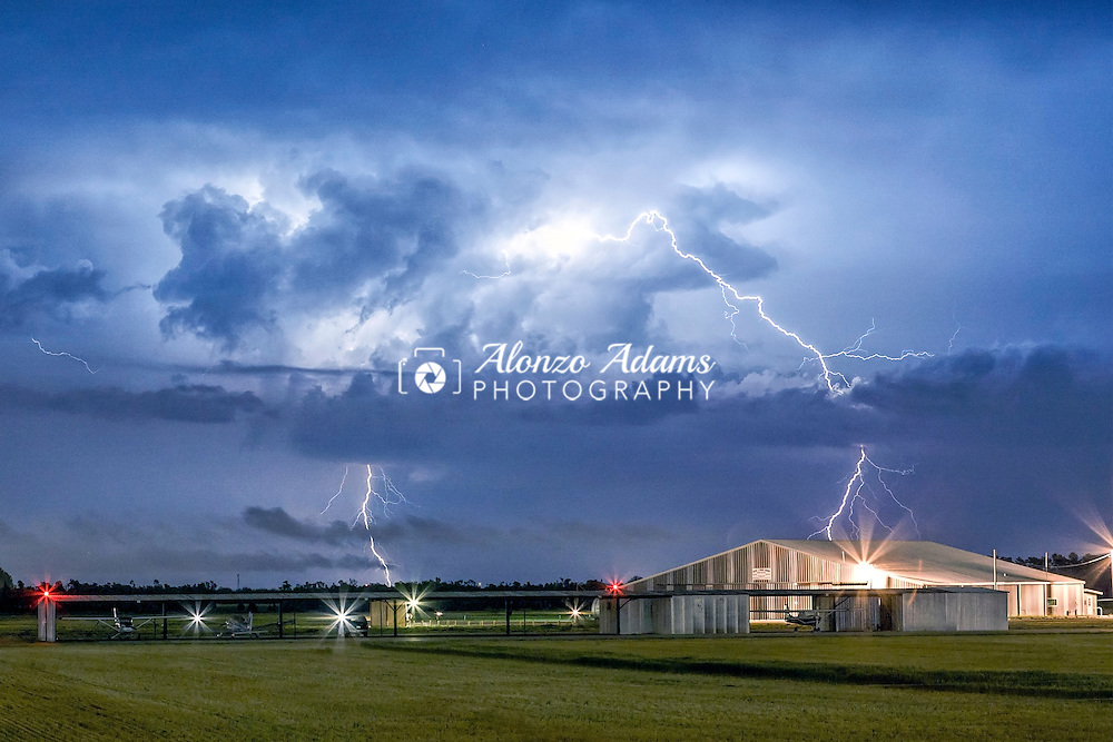 Lightning over an airport in Cleveland County in Oklahoma on April 22, 2011. (Photo copyright © 2011 Alonzo J. Adams)