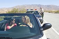 Two women reading speeding ticket in car