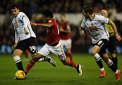 George Thorne of Derby County (L) and Ryan Mendes of Nottingham Forest in action - Mandatory byline: Jack Phillips / JMP - 07966386802 - 6/11/2015 - FOOTBALL - The City Ground - Nottingham, Nottinghamshire - Nottingham Forest v Derby County - Sky Bet Championship