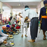 The langar at Golden temple at Amritsar, where 60000 free meals are served everyday, and that mostly relies on volunteers to run it.
