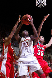 March 21, 2011; Stanford, CA, USA; Stanford Cardinal forward Chiney Ogwumike (13) shoots past St. John's Red Storm guard Shenneika Smith (35) and guard Nadirah McKenith (5) during the second half of the second round of the 2011 NCAA women's basketball tournament at Maples Pavilion. Stanford defeated St. John's 75-49.