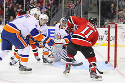 Jan 31, 2013; Newark, NJ, USA; New Jersey Devils right wing Stephen Gionta (11) looks for a rebound after a save by New York Islanders goalie Evgeni Nabokov (20) during the second period at the Prudential Center.
