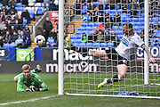Bolton Wanderers Defender, David Wheater clears the ball off the line during the Sky Bet Championship match between Bolton Wanderers and Reading at the Macron Stadium, Bolton, England on 2 April 2016. Photo by Mark Pollitt.