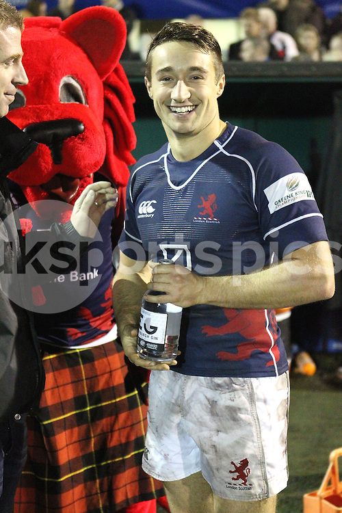 Miles Mantella collects his 'Man of the Match' award after the Green King IPA Championship match between London Scottish &amp; Jersey at Richmond, Greater London on Friday 14th November 2014<br /> <br /> Photo: Ken Sparks | UK Sports Pics Ltd<br /> London Scottish v Jersey, Green King IPA Championship,14th November 2014<br /> <br /> &copy; UK Sports Pics Ltd. FA Accredited. Football League Licence No:  FL14/15/P5700.Football Conference Licence No: PCONF 051/14 Tel +44(0)7968 045353. email ken@uksportspics.co.uk, 7 Leslie Park Road, East Croydon, Surrey CR0 6TN. Credit UK Sports Pics Ltd
