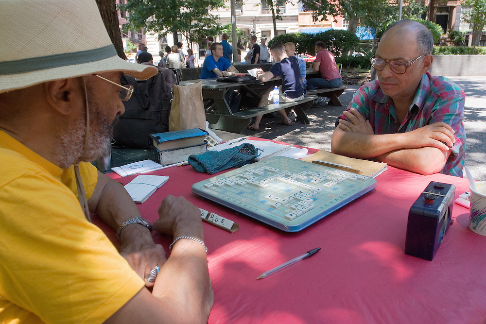 NEW YORK, USA: Two men play scrabble on a sunny Sunday morning at Chelsea Park in Manhattan.