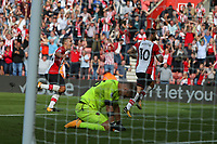 Football - 2017 / 2018 Premier League - Southampton vs. West Ham United<br /> <br /> Southampton's Charlie Austin celebrates scoring his late penalty with Southampton's Oriol Romeu as a distraut Joe Hart of West Ham on his knees at St Mary's Stadium Southampton<br /> <br /> COLORSPORT/SHAUN BOGGUST