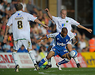 Picture by Ady Kerry/Focus Images Ltd.  .26/09/09.Gillingham's Simeon Jackson challenges Norwich's Stephen Hughes and Jens Berthel Askou during their Coca-Cola League 1 game at the Priestfield Stadium, Gillingham, Kent.
