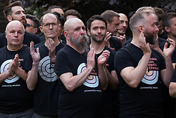 London, UK. 30th April 2019. London Gay Men's Chorus joins survivors of the Admiral Duncan bombing, families and friends of the victims and the LGBTQ community at a service of remembrance outside St Anne's church in Soho to mark 20 years since the attack. Three people were killed and 79 injured when a bomb packed with up to 1,500 four-inch nails was detonated by a neo-Nazi at the Admiral Duncan on 30th April 1999.