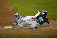 Muskrats Braxton Martinez tags out Mountaineers Jack Parenty during Tuesday night's playoff game two.  (Karen Bobotas/for the Laconia Daily Sun)