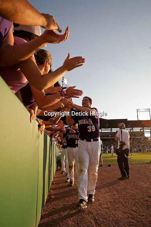 06 June 2009:  LSU player Nolan Cain (39) celebrates with fans following a 5-3 victory by the LSU Tigers over the Rice Owls in game two of the NCAA baseball College World Series, Super Regional played at Alex Box Stadium in Baton Rouge, Louisiana. The Tigers with the win advance to next week's College Baseball World Series in Omaha, Nebraska.