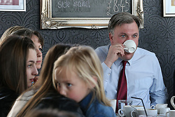 © Licensed to London News Pictures . 11/04/2015 . Bury , UK . Labour Shadow Chancellor ED BALLS (r) and James Frith , Labour candidate for Bury North , at a campaign stop at Barista coffee shop at The Rock , Bury in Greater Manchester , UK . The pair met parents and discussed family finances . Photo credit : Joel Goodman/LNP