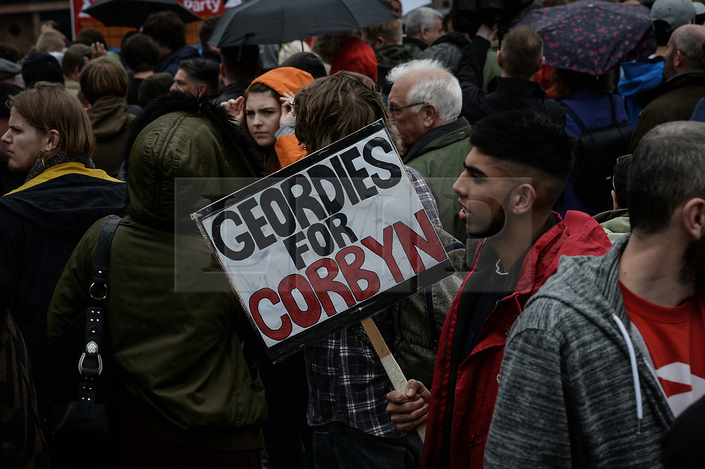 © Licensed to London News Pictures. 05/06/2017. Newcastle Upon Tyne, UK. Supporters carry homemade signs as they wait for Jeremy Corbyn MP, Leader of the Labour Party, to speak outside the Sage in Gateshead. Mr Corbyn spent one of the final days of the campaign trail in the Labour heartlands of North-East England before voters go to the polls in the UK General Election on June 8th 2017. Photo credit: MARY TURNER/LNP