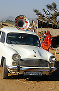 An Ambassador car with a loud speaker mounted on the roof, at the Pushkar Fair, Rajasthan, India.